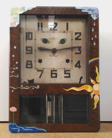 斎藤雨梟作「お天気屋さんの猫の目時計」写真